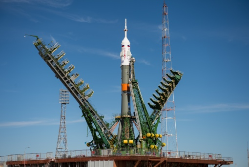 The gantry arms close around the Soyuz MS-04 spacecraft to secure the rocket at the launch pad on Monday, April 17, 2017 at the Baikonur Cosmodrome in Kazakhstan. Launch of the Soyuz rocket is scheduled for April 20 Baikonur time and will carry Expedition 51 Soyuz Commander Fyodor Yurchikhin of Roscosmos and Flight Engineer Jack Fischer of NASA into orbit to begin their four and a half month mission on the International Space Station. Photo Credit: (NASA/Aubrey Gemignani)